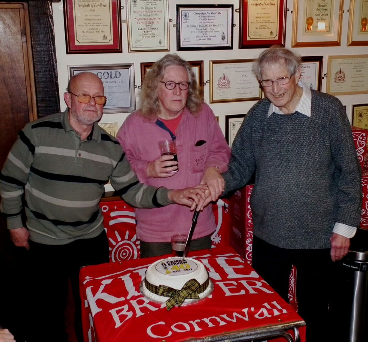 Kernow CAMRA founding members cutting the 40th Anniversary cake .Brian Phillips, Richard Cunningham and Gerry Bazin.