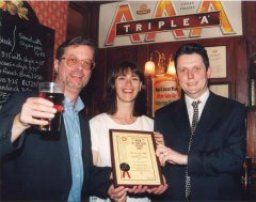 First time in the winner's enclosure for the Larner's and this popular Young's pub. John Cryne of CAMRA (left) does the honours. Anybody remember Triple A?