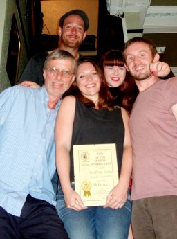 Picture shows Branch Chairman John Cryne (left) with the pub's management team - Joel, Susie, Aidan and Bel.