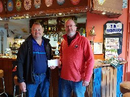 Receiving donation from Tim Webster