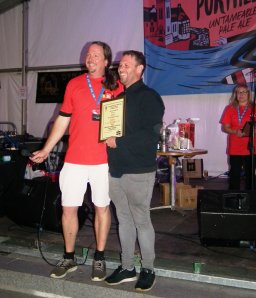 Marco from St Ives Brewery picking up his award