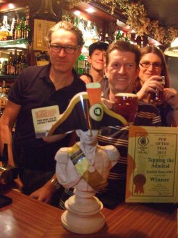 Nelson looks serious as Catherine Tonry (Branch Chairman back right) celebrates with the Tapping Team their Pub of the Year 2013 Award.