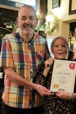 Anne and Nick from the Duke of Edinburgh, Woodside with their Long Service award for 18 years service at the pub. 27/02/20