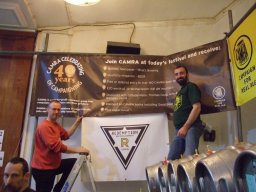 Andy Parkinson and friend get the London LocAle Bar set up at the 2011 Festival during CAMRA's 40th Birthday year.