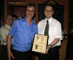 John Cryne of CAMRA (left) presents the Pub of the Year Award to Adrian Larner of the Calthorpe Arms.
