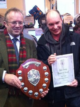 Torquil Sligo-Young (left) presents Andy Moffat with his award