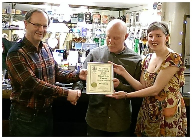 Paul Burgess presenting Rob & Anne-Marie Powell at the Real Ale Farm with their Club of the Year certificate for 2017.