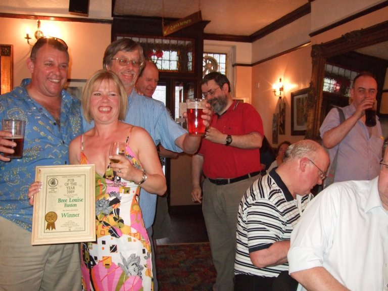Licensees Craig and Karen Douglas enjoy the Award ceremony with Branch chairman John Cryne and other Branch members.