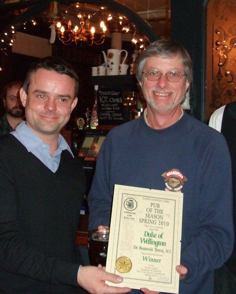 Ed Mason (left) accepts the Award from Branch Chairman John Cryne. The pub is a member of CAMRA's LocAle scheme. It flies the flag for real ale on the Balls Pond Rd.