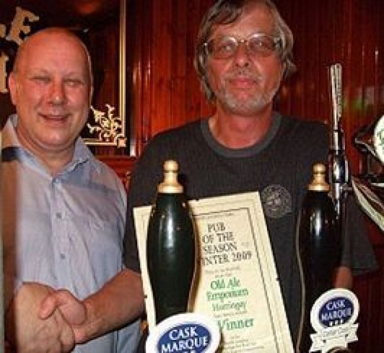 Dave Smith (left) takes the Award from Chairman John Cryne. This small street corner pub has taken great steps to improve real ale on Green Lanes.