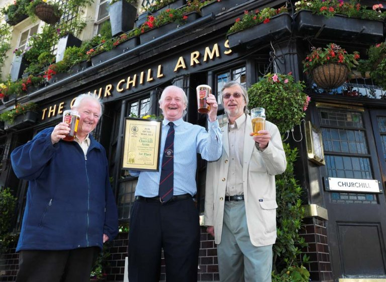 Churchill Arms is West London's Pub of the Year from left to right Les Maggs (W London) Gerry O'Brien (Churchill Arms) John Cryne (CAMRA London)