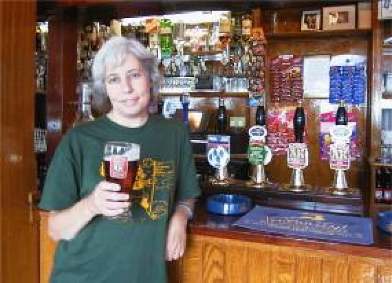 jane jephcote with pint of real ale