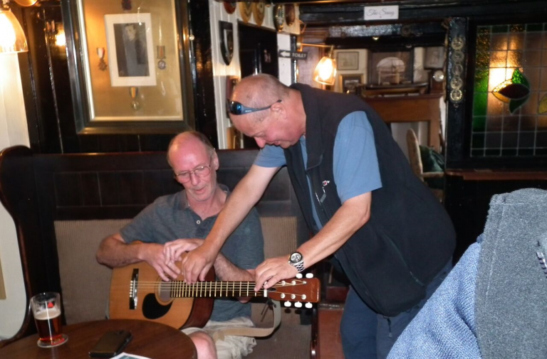 Len learning the strings from Jim