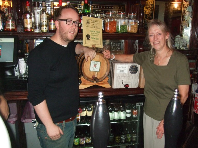 Nigel Owen (left) at The Queen's Head, Acton St., accepts the 2013 Greater London Cider Pub of the Year Award from CAMRA's Christine Cryne.
