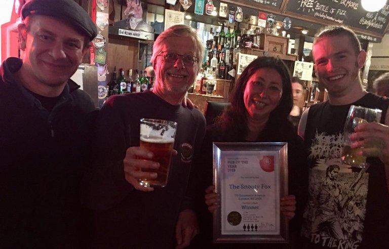 Jonathan, John Cryne (CAMRA), Nicole and Al accept their Award.