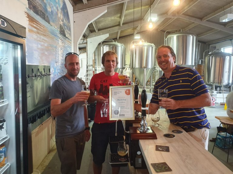 Falmouth Beer Festival Presentation to the Nico and Ben at the Black Flag Brewery. Bronze Award for Champion Golden ale of Cornwall 2018 for Chameleon