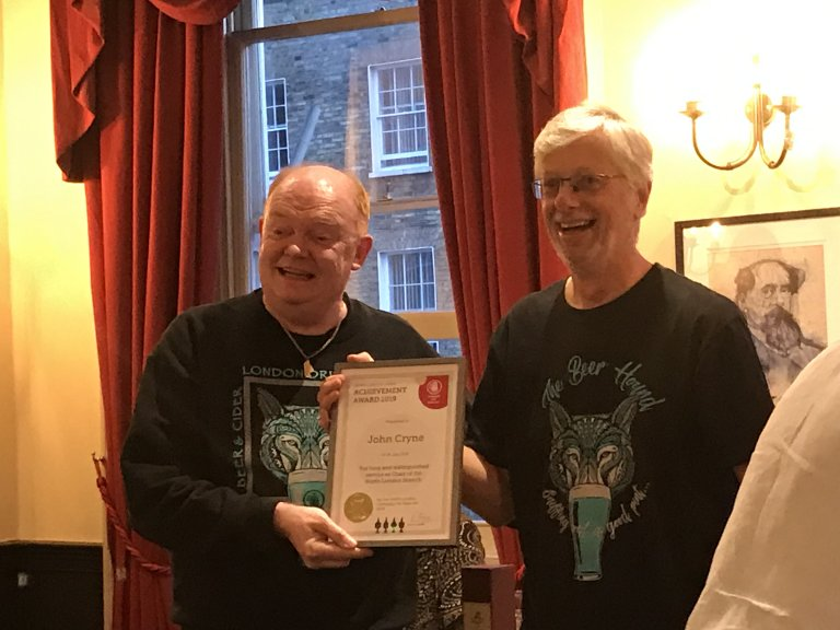 Outgoing Branch Chairman John Cryne accepts an Achievement Award from incoming Chairman, Colin Coyne.