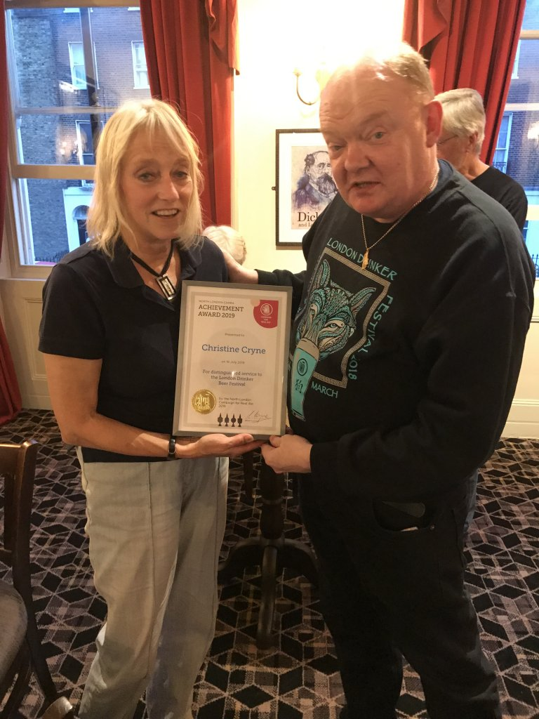 The last-ever London Drinker Beer & Cider Festival Organiser, Christine Cryne, receives an Achievement Award from Branch Chairman, Colin Coyne.