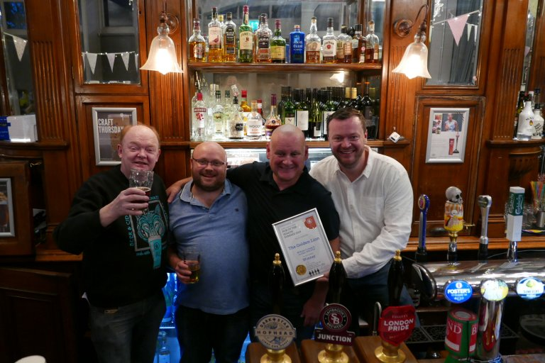 Branch Chairman Colin Coyne (left) presents the Winter Pub of the Season Award to (left to right) Trevor (licensee), Dave Murhpy (owner) and Aaron (licensee)