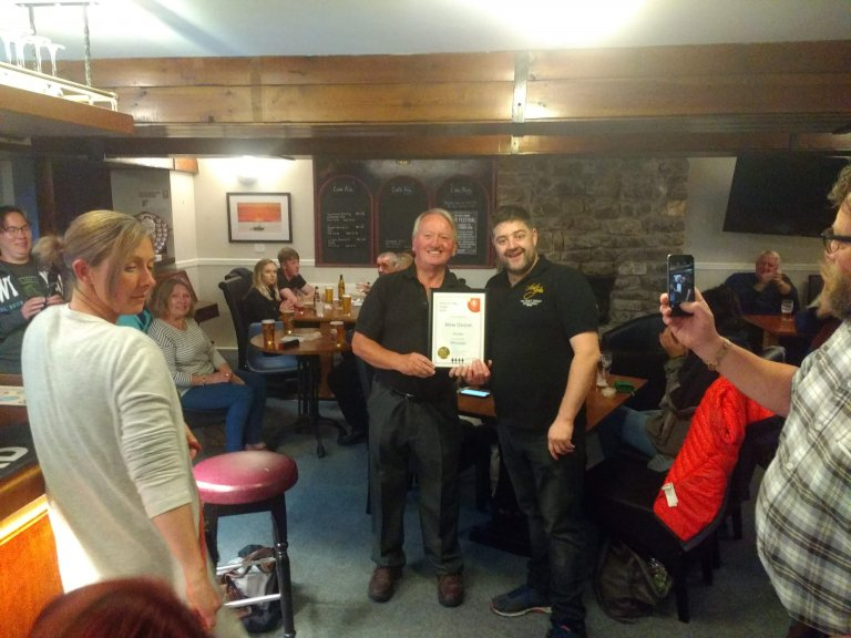 Phil Walker accepting Cumbria Pub of the Year for the New Union from Dave Stubbins