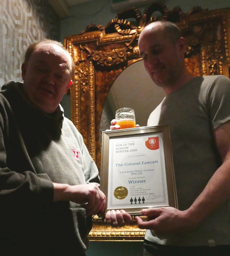 Branch Chairman Colin Coyne (left) presents Paul Evans with the Award.