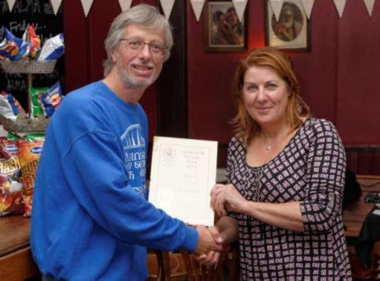 John Cryne of CAMRA (left) presents Kirsty Valentine of The Alma N1 with the Branch Cider Pub of the Year Award 2013.