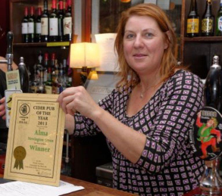 Landlady Kirsty Valentine shows off the Award