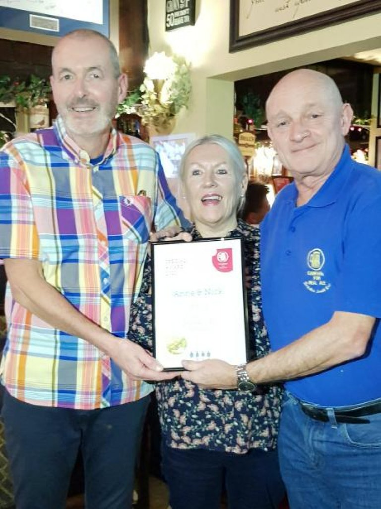 Branch Chairman Kevin Lenton presenting Anne and Nick from the Duke of Edinburgh, Woodside with a  Long Service award for 18 years service at the pub. 27/02/20