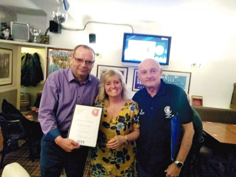 Branch Chairman Kevin Lenton presenting a Long Service award to Graham & Dawn at the Rifle Volunteer, Emmbrook for 18 years service at the pub.