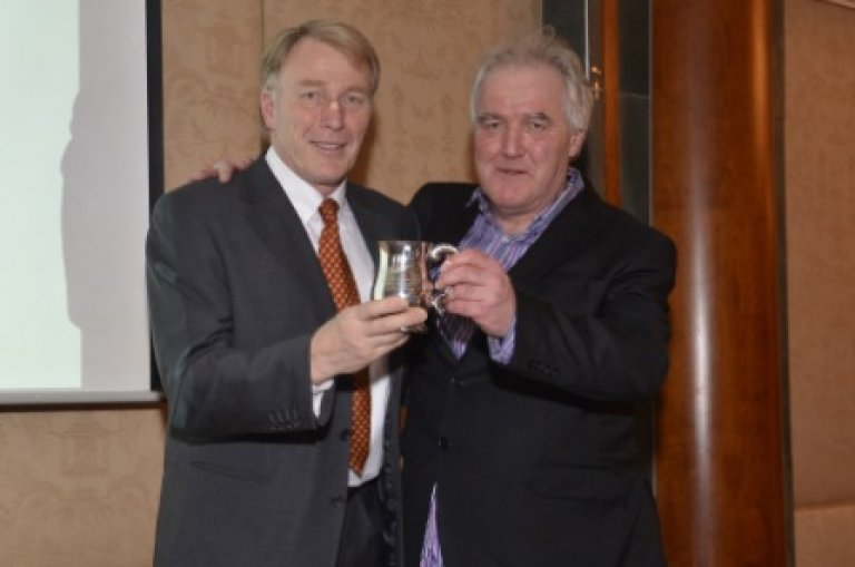 Derek Prentice (left) receives the Award as Brewer of the Year from Tim Hampson, Chairman British Guild of Beer Writers