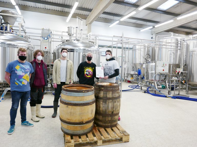 left to right:  Nigel Tarn (Brewery Manager), Robin Murphy (Brewer), Gareth Hilton (Head Brewer), John Cryne (CAMRA) and Julio Moncada (owner)