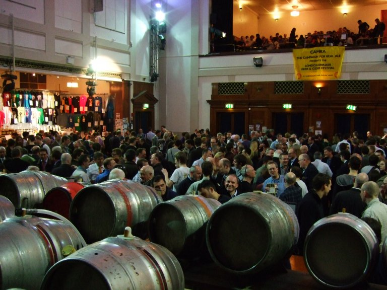 A view from behind the barrels on the stage looking up to a full balcony.
