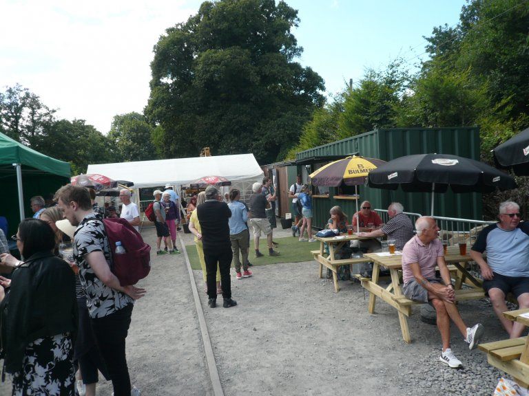 In the goods yard with the Craft Ale bar on the right