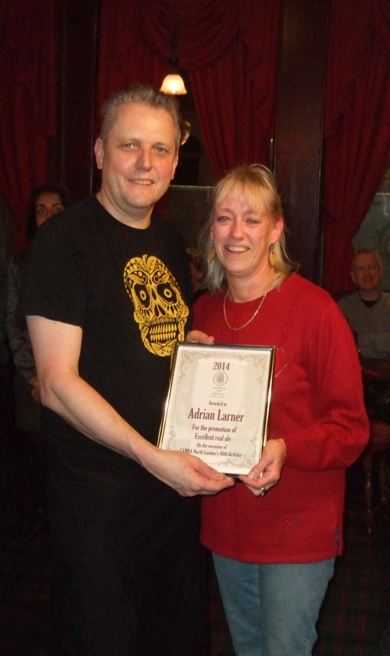 Adrian Larner accepts his Award from Christine Cryne