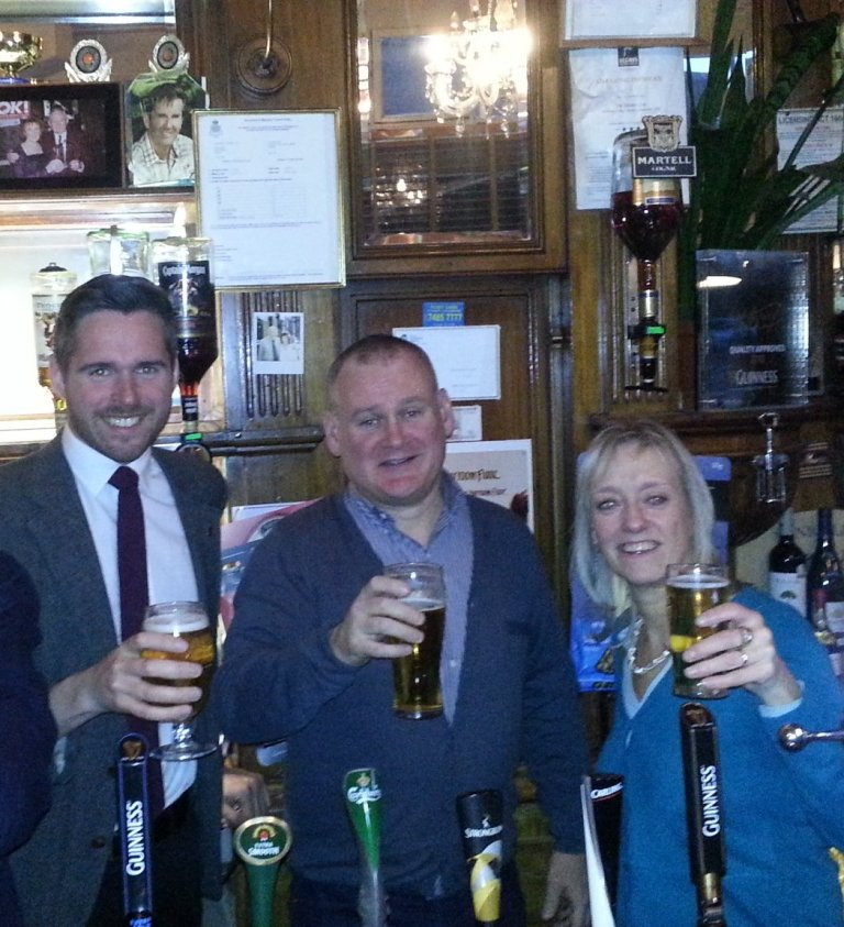 Tom Copley (left), Dave Murphy and Christine Cryne of CAMRA toast the campaign to save The Golden Lion