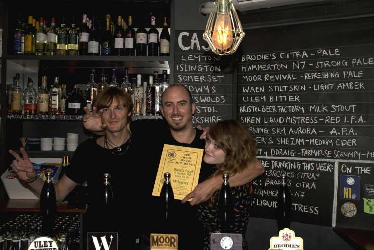 Tom Harrison (centre) and Lottie Judge (right) celebrate with a member of the bar team. Pic Steve Newton.