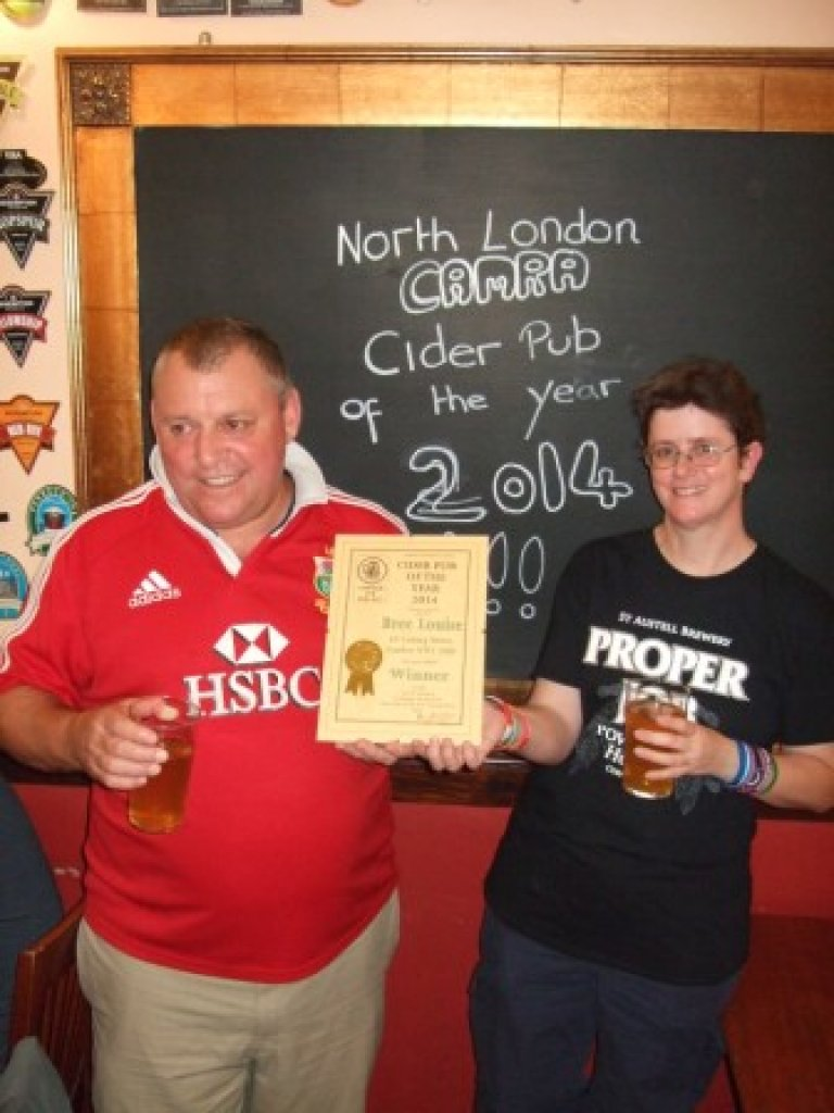 Craig Douglas accepts the North London Cider Pub of the Year Award from Jess Marsh.