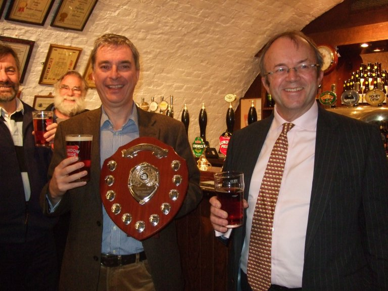 John Keeling holds the John Young Memorial Award Shield presented by Torquil Sligo-Young, right.