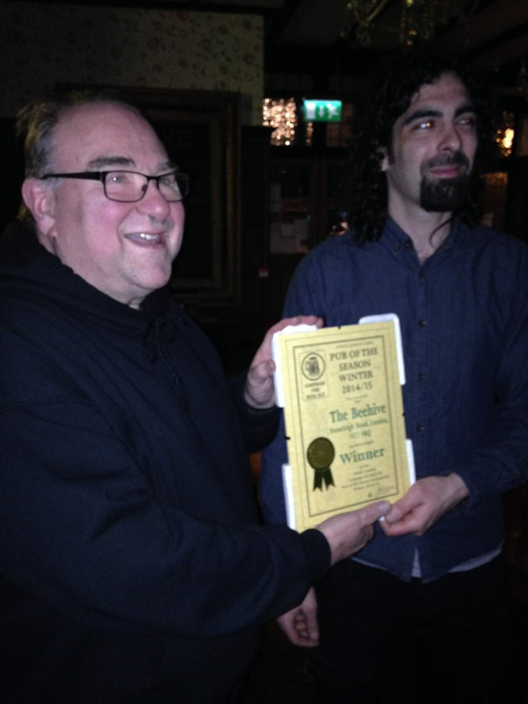 Ian McLaren (CAMRA left) presents Alex Abyad with the Beehive's Award.