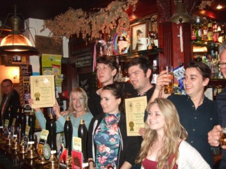 Christine Cryne (left with certificate) helps the Tapping team celebrate their success in the CAMRA North London 2015 Pub of the Year competition.