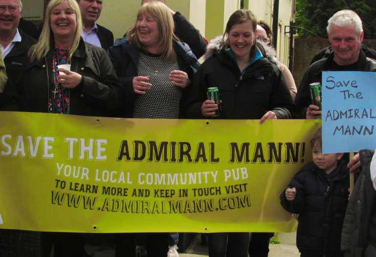 Regulars gather to demonstrate their anger at The Admiral Mann's closure.