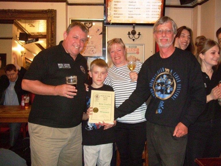 Craig and Karen Douglas with son George receive their Award from John Cryne