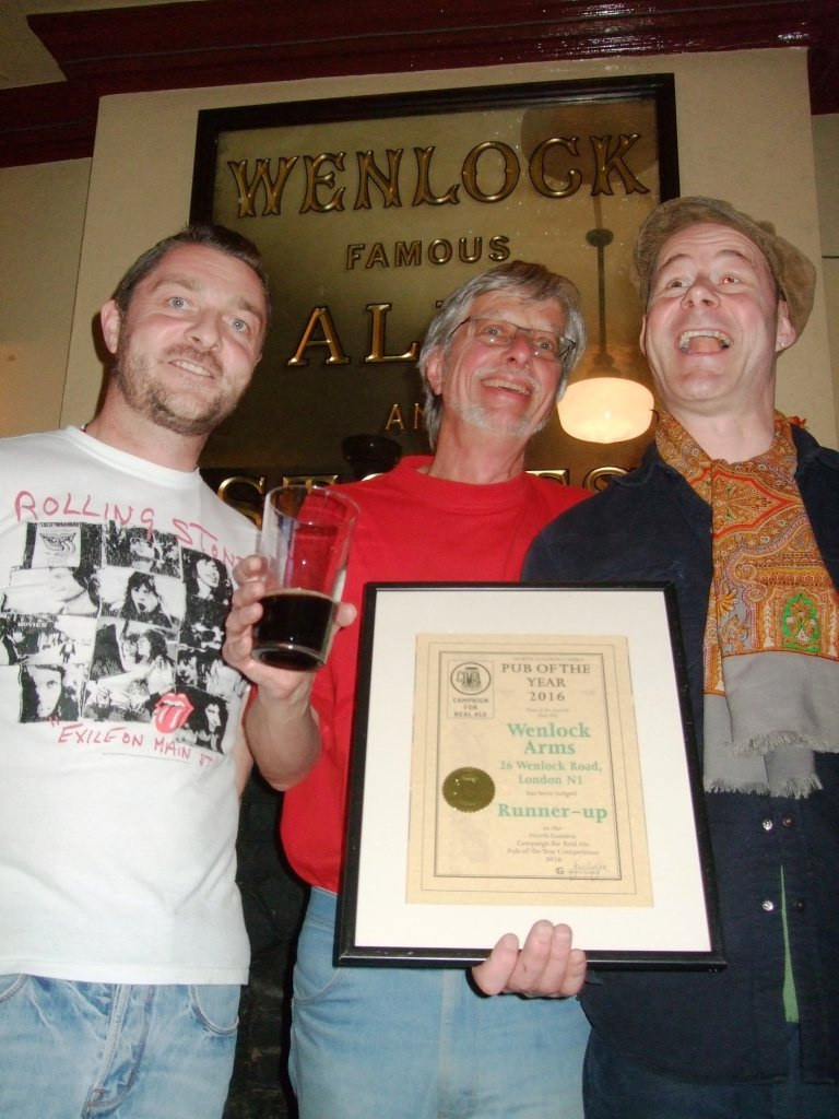 Ian Screeton (L) and Marcus Grant (R) are all smiles on receiving their 2016 Pub of the Year Runner-up Award from John Cryne.