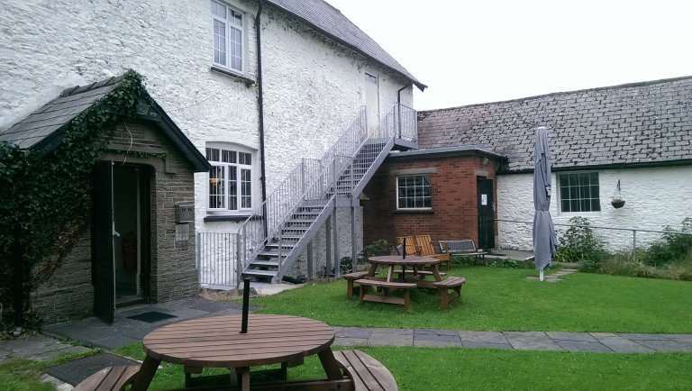 Garden and entrance of Real Ale Farm club in Gilfach Fargoed.