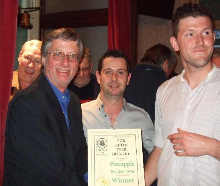 Branch Chairman John Cryne (left) presents to Award to pub managers Simon Rennie and Chris Johnson.