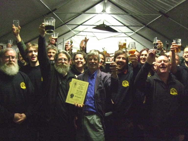 Regional Director John Cryne raises a toast with staff to celebrate The Hope, Carshalton being London's 2012 Pub of the Year.